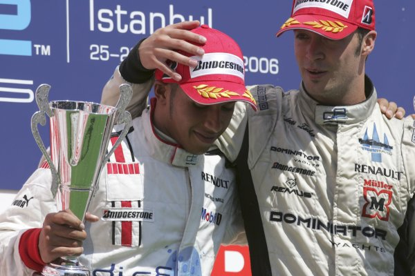 2006 GP2 Series. Round 10.Istanbul Park, Istanbul Turkey.27th August 2006.Sunday Race.Andreas Zuber (AUT, Trident Racing) celebrates victory on the podium with Lewis Hamilton (GBR, ART Grand Prix).World Copyright: Charles Coates/GP2 Series Media Service.ref: Digital Image MB5C8614