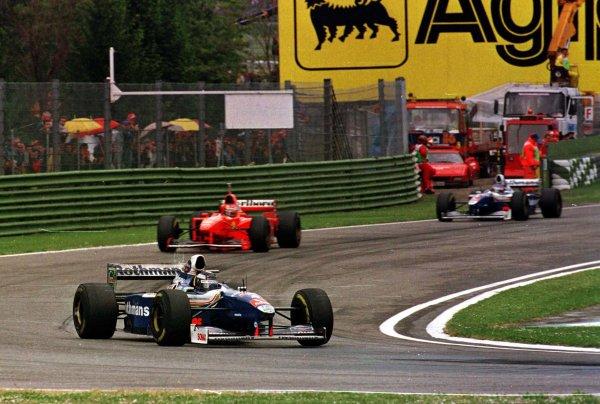 1997 San Marino Grand Prix.Imola, Italy.25-27 April 1997.Heinz-Harald Frentzen (Williams FW19 Renault) leads Michael Schumacher (Ferrari F310B) and Jacques Villeneuve (Williams FW19 Renault) early on in the race at Tamburello. Frentzen finished in 1st position.World Copyright - LAT Photographic