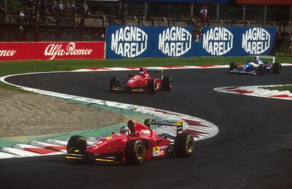 1994 Italian Grand Prix.Monza, Italy.9-11 September 1994.Jean Alesi leads teammate Gerhard Berger (both Ferrari 412T1B's) and Damon Hill (Williams FW16B Renault) through the Rettifilo Chicane. Ref-94 ITA 10.World Copyright - LAT Photographic