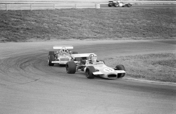 John Watson, Brabham BT30 Ford, leads Carlos Pace, March 712M Ford.
