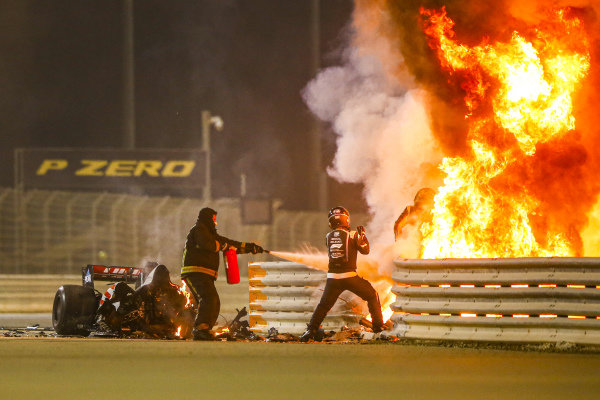 Romain Grosjean, Haas F1 getting out of his car that is on fire
