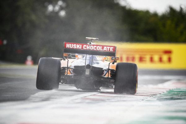Carlos Sainz Jr., McLaren MCL34, kicks up cement dust
