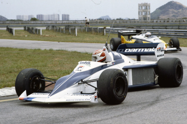 Nelson Piquet, Brabham BT52 BMW, leads Alain Prost, Renault RE30C, in the pitlane.