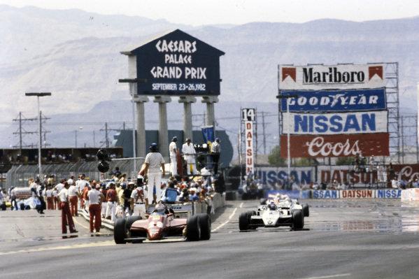 Mario Andretti, Ferrari 126C2, leads Keke Rosberg, Williams FW08 Ford.