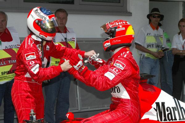 2002 Austrian Grand Prix - QualifyingA-1 Ring, Zeltweg, Austria. 11th May 2002Michael Schumacher, Ferrari F2002, congratulates team mate Rubens Barrichello, after the Brazilian secured pole position.World Copyright: Pic Steve Etherington/LATref: Digital Image Only