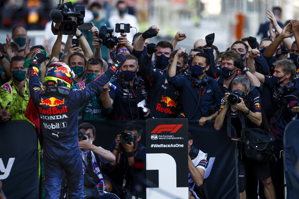 Sergio Perez, Red Bull Racing, 1st position, celebrates with his team in Parc Ferme