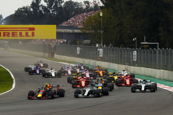 Max Verstappen, Red Bull Racing RB14, leads Lewis Hamilton, Mercedes AMG F1 W09 EQ Power+, Max Verstappen, Red Bull Racing RB14, and Valtteri Bottas, Mercedes AMG F1 W09 EQ Power+, at the start of the race