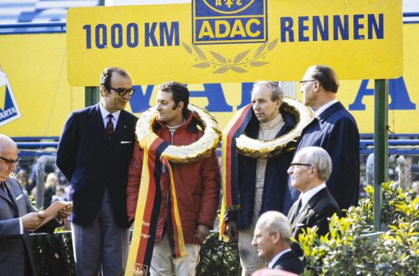 Winners of the S5.0 class Nino Vaccarella and John Surtees on the podium.