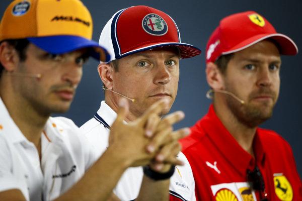 Carlos Sainz Jr, McLaren, Kimi Raikkonen, Alfa Romeo Racing and Sebastian Vettel, Ferrari in the Press Conference