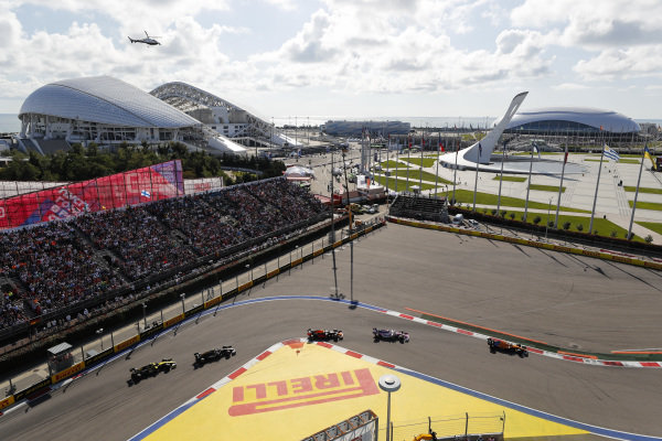 Lando Norris, McLaren MCL34, leads Sergio Perez, Racing Point RP19, Max Verstappen, Red Bull Racing RB15, Kevin Magnussen, Haas VF-19 and Nico Hulkenberg, Renault R.S. 19