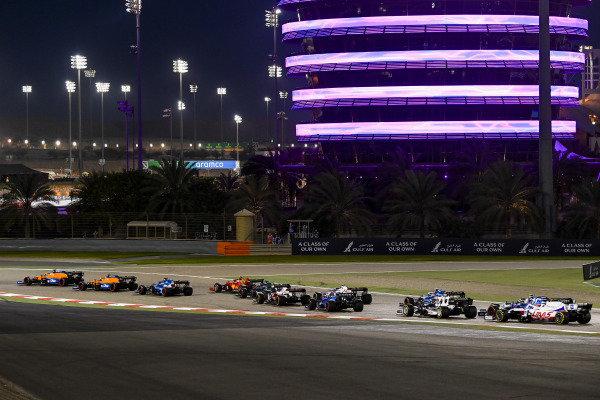 Daniel Ricciardo, McLaren MCL35M, leads Lando Norris, McLaren MCL35M, Fernando Alonso, Alpine A521, Carlos Sainz, Ferrari SF21, and the remainder of the field at the start