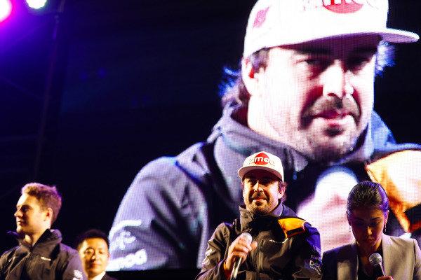 Fernando Alonso, McLaren, and Stoffel Vandoorne, McLaren, attend a fan event.