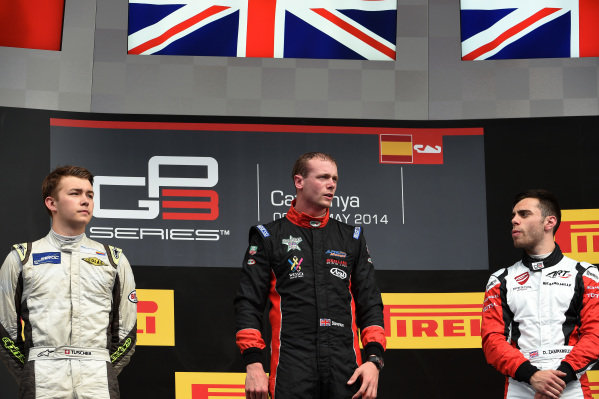 Race two podium (L to R): Second placed Matheo Tuscher (SUI) Jenzer Motorsport, race winner Dean Stoneman (GBR) Marussia Manor Racing and third placed Dino Zamparelli (GBR) ART Grand Prix. GP3 Series, Rd1, Barcelona, Spain, 9-11 May 2014.