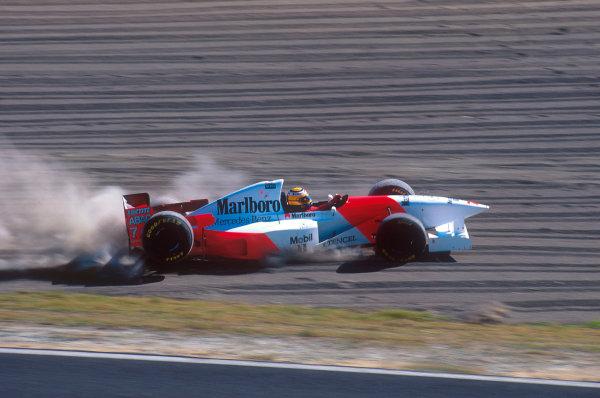 Suzuka, Japan.27-29 October 1995.Mark Blundell (McLaren MP4/10B Mercedes) takes a trip through the gravel trip.Ref-95 JAP 04.World Copyright - LAT Photographic