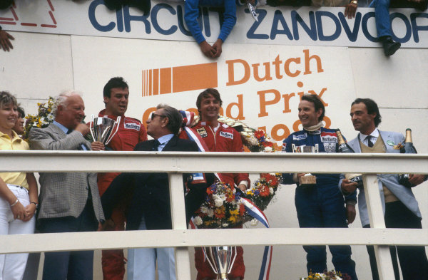Zandvoort, Holland.26-28 August 1983.Rene Arnoux, 1st position, Patrick Tambay, 2nd position (both Ferrari) and John Watson (McLaren Ford) 3rd position on the podium. FIA President Jean-Marie Balestre stands at the front.Ref-83 HOL 02.World Copyright - LAT Photographic