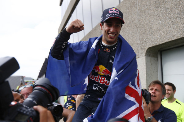 Circuit Gilles Villeneuve, Montreal, Canada. Sunday 8 June 2014. Daniel Ricciardo, Red Bull Racing, 1st Position, celebrates his maiden win with his team. World Copyright: Andy Hone/LAT Photographic. ref: Digital Image _ONZ3782