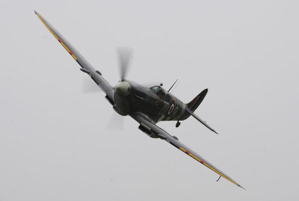 2014 Goodwood Revival Meeting Goodwood Estate, West Sussex, England 12th - 14th September 2014.  A Spitfire flies low over the cricket match.  World Copyright: Jeff Bloxham/LAT Photographic ref: Digital Image DSC_0067