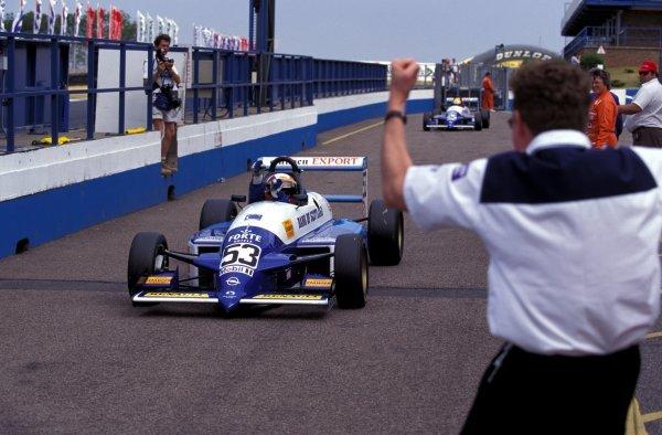 Race winner Juan Pablo Montoya (COL) Paul Stewart Racing is cheered into the pitlane.GM Opel Euroseries, Rd8 & Rd9, Donington Park, England, 8-9 July 1995.