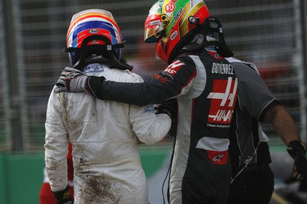 Albert Park, Melbourne, Australia. Sunday 20 March 2016. Esteban Gutierrez, Haas F1, and Fernando Alonso, McLaren, immediately after their collision. World Copyright: Sam Bloxham/LAT Photographic ref: Digital Image _R6T3683