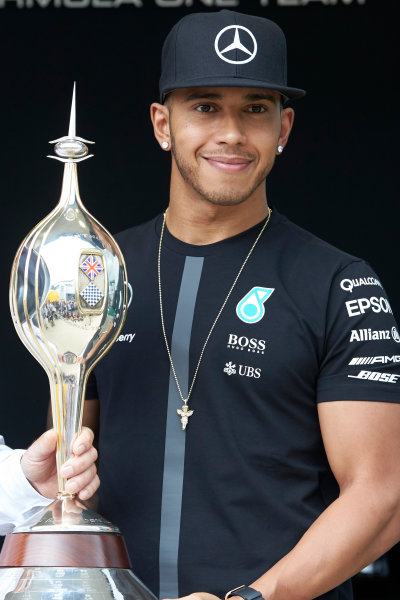 Silverstone Circuit, Northamptonshire, England. Thursday 2 July 2015. Lewis Hamilton, Mercedes AMG is presented with the Mike Hawthorn Memorial Trophy. World Copyright: Steve Etherington/LAT Photographic ref: Digital Image SNE29201