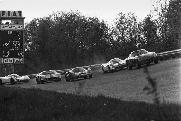 Monza, Italy. 25th April 1968. Rd 4. Pierre Sudan/Cox Kocher (Ferrari 275 GTB), retired, leads Jo Siffert/Hans Herrmann (Porsche 908 LH), 19th position, Antonio Nicodemi/Carlo Facetti (Porsche 910), 5th position, Paul Hawkins/David Hobbs (Ford GT40), 1st position and Ludovico Scarfiotti/Gerhard Mitter (Porsche 908 LH), 11th position, action.  World Copyright: LAT Photographic. Ref: L68/394 36A.