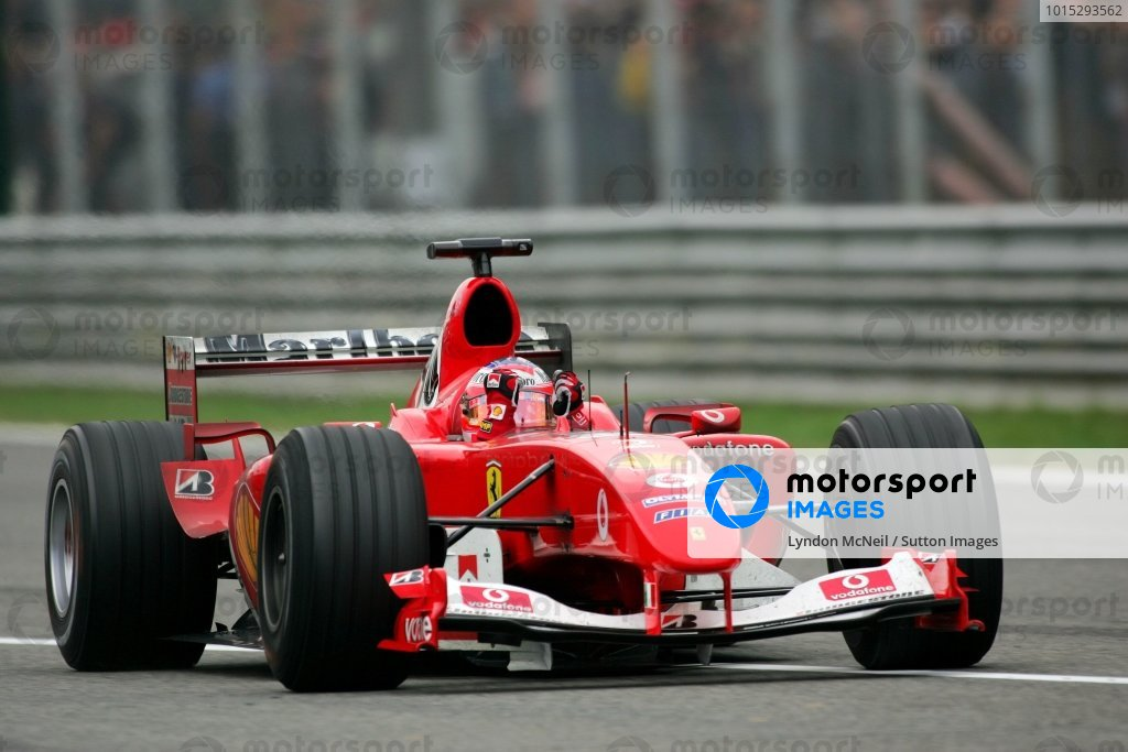 Race winner Rubens Barrichello (BRA) Ferrari F2004 waves to the crowd on his way to Parc Ferme.