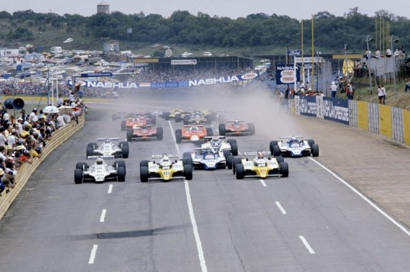 1980 South African Grand Prix.Kyalami, South Africa. 28 February-1 March 1980.Alan Jones (#27 Williams FW07B-Ford Cosworth), Rene Arnoux (#16 Renault RE20) and Jean-Pierre Jabouille (#15 Renault RE20) lead at the start.World Copyright: LAT PhotographicRef: 35mm transparency 80SA05