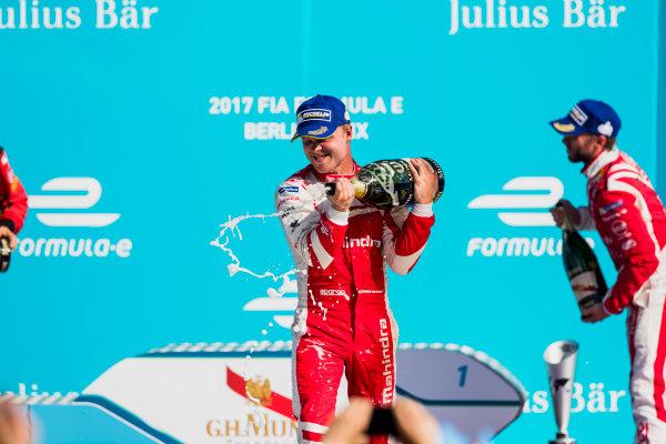 2016/2017 FIA Formula E Championship. Round 7 - Berlin ePrix, Tempelhof Airport, Berlin, Germany. Saturday 10 June 2017. Felix Rosenqvist (SWE), Mahindra Racing, Spark-Mahindra, Mahindra M3ELECTRO, sprays the champagne on the podium. Photo: Zak Mauger/LAT/Formula E ref: Digital Image _54I7691