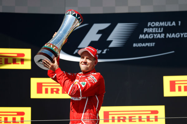 Hungaroring, Budapest, Hungary.  Sunday 30 July 2017. Sebastian Vettel, Ferrari, 1st Position, with his trophy. World Copyright: Glenn Dunbar/LAT Images  ref: Digital Image _X4I2881