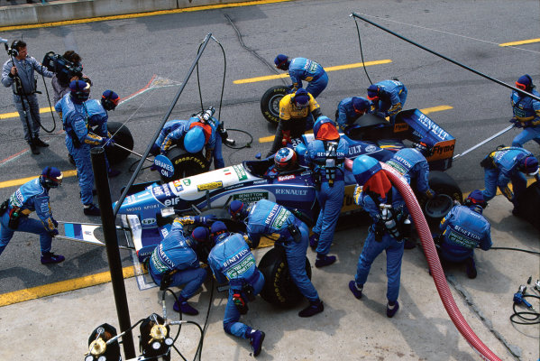 Montreal, Quebec, Canada. .9-11 June 1995. Michael Schumacher (Benetton B195 Renault) 5th position, pit stop, action.  World Copyright: LAT Photographic. Ref:  95 CAN 13.