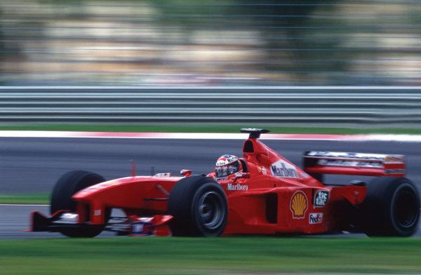 Sepang, Kuala Lumpur, Malaysia. .15-17 October 1999.  Michael Schumacher (Ferrari F399), 2nd position, action. World Copyright: LAT Photographic. Ref:  99 MAL 30