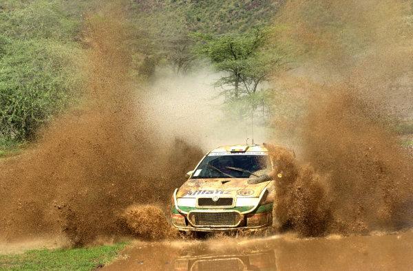 2001 World Rally Championship.Nairobi, Kenya. July 20-22, 2001Bruno Thiry makes a splash in section 8.Photo: Ralph Hardwick/LAT