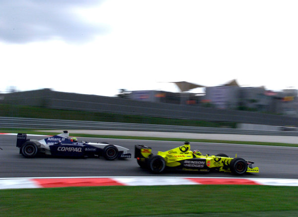 2001 Malaysian Grand Prix.Sepang, Kuala Lumpur, Malaysia. 16-18 March 2001.Ralf Schumacher (Williams FW3 BMW) and Heinz-Harald Frentzen (Jordan EJ11 Honda) battle for position.World Copyright - Steve Etherington/LAT Photographic.ref: 18mb Digital Image