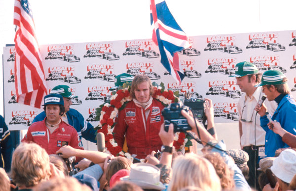 1976 Canadian Grand Prix.Mosport Park, Ontario, Canada.1-3 October 1976.James Hunt (McLaren Ford) 1st position and Mario Andretti (Team Lotus) 3rd position on the podium.Ref-76 CAN 03.World Copyright - LAT Photographic