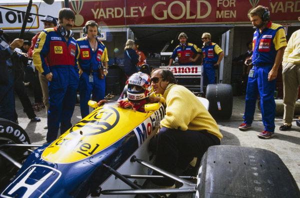 Nigel Mansell, Williams FW11 Honda, with Jackie Stewart.