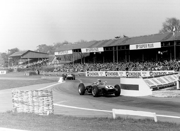 Goodwood, Sussex, Great Britain. 18th April 1960. Innes Ireland (Lotus 18-Climax), 1st position leads Stirling Moss (Cooper T51-Climax), action.  World Copyright: LAT Photographic.  Ref: 8596C - 30A.