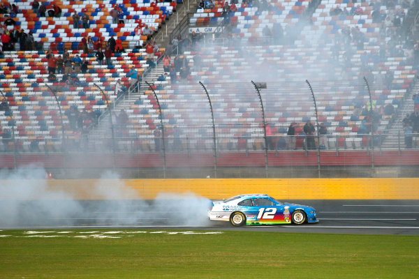 6-7 October, 2016, Concord, North Carolina USA Joey Logano does a burn out to celebrate his win ?2016, Lesley Ann Miller LAT Photo USA