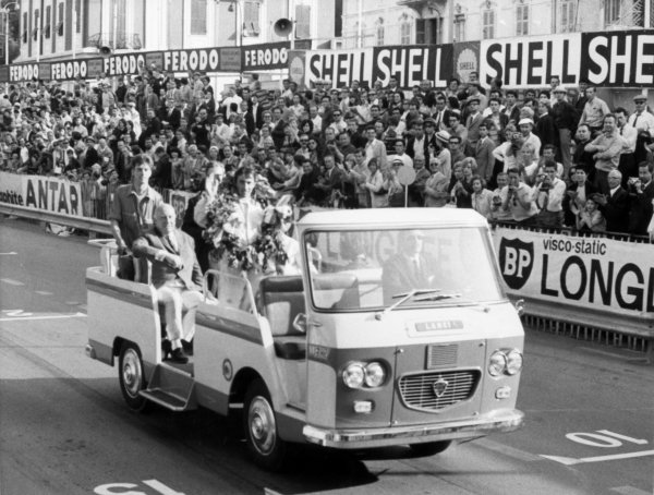 1966 Monaco Grand Prix. Monte Carlo, Monaco. 22 May 1966. Jackie Stewart, BRM P261, 1st position, waves to the crowd on his victory parade. World Copyright: LAT Photographic Ref: Motor b&w print