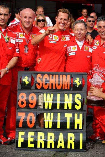 2006 German Grand Prix - Sunday Race Hockenheim, Germany. 27th - 30th July. Michael Schumacher, Ferrari 248F1, 1st position, celebrates his 89th win and 70th for Ferrari, portrait. World Copyright: Lorenzo Bellanca/LAT Photographic ref: Digital Image AZD2J2164