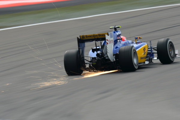 Felipe Nasr (BRA) Sauber C34 throw up some sparks at Formula One World Championship, Rd3, Chinese Grand Prix, Practice, Shanghai, China, Friday 10 April 2015.