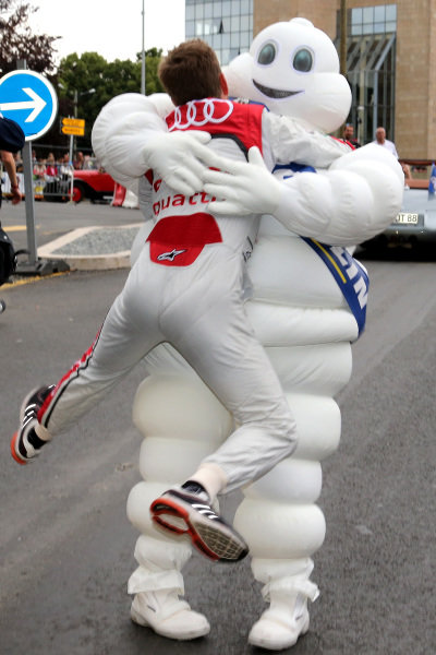 Allan McNish (GBR) Audi Sport Team Joest, gives the Michelin Man a hug on the Drivers Parade, 21 June 2013. Le Mans 24 Hours, Le Mans, France, 20-23 June 2013.