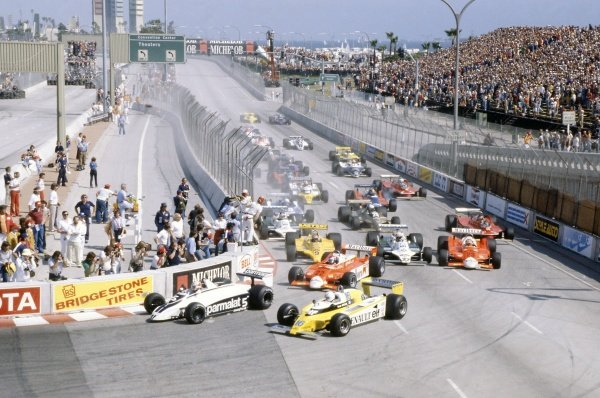 1980 United States Grand Prix West.Long Beach, California, USA. 28-30 March 1980.Nelson Piquet (Brabham BT49-Ford Cosworth) leads Rene Arnoux (Renault RE20), Patrick Depailler (Alfa Romeo 179B), Jan Lammers (ATS D4-Ford Cosworth), Alan Jones (Williams FW07B-Ford Cosworth) and Bruno Giacomelli (Alfa Romeo 179B) at the start.World Copyright: LAT PhotographicRef: 35mm transparency 80LB17