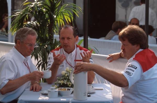 l-r, Jurgen Schremp, Ron Dennis and Norbert Haugh discuss McLarens tactics over breakfast. German GP, Hockenheim, 30 July 1995