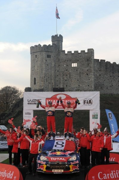 Sebastien Loeb (FRA) and Daniel Elena (MCO) celebrate their 8th World Rally Championship title with the Citroen Team on the podium in Cardiff Castle.