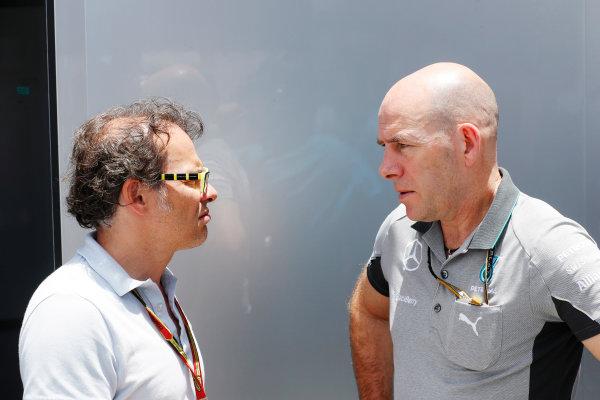 Interlagos, Sao Paulo, Brazil. Friday 7 November 2014. Jacques Villeneuve with Jock Clear, Race Engineer, Mercedes AMG. World Copyright: Charles Coates/LAT Photographic. ref: Digital Image _N7T8196