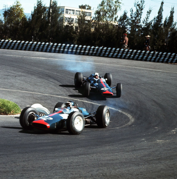 Mexico City, Mexico.22-24 October 1965.Bob Bondurant (Lotus 33 BRM) leads Dickie Attwood (Lotus 25 BRM). Attwood finished in 6th position.Ref-3/1861.World Copyright - LAT Photographic
