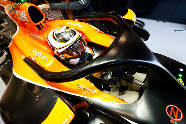 Spa Francorchamps, Belgium.  Friday 25 August 2017. Stoffel Vandoorne, McLaren, in garage, with hal device attached to is cockpit. World Copyright: Steven Tee/LAT Images  ref: Digital Image _O3I0455