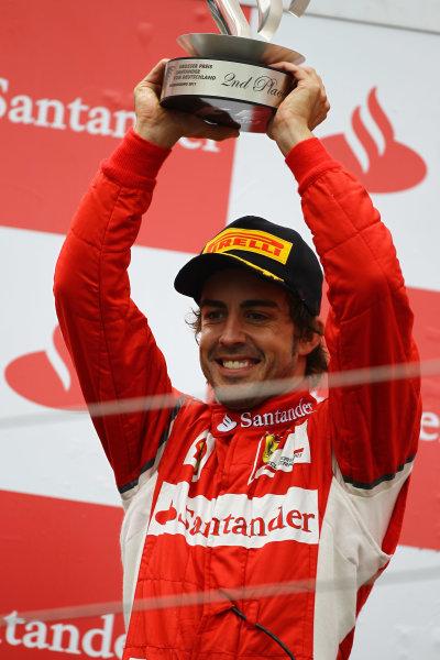 Nurburgring, Germany.24th July 2011Fernando Alonso, Ferrari 150° Italia, 2nd position, lifts his trophy. Portrait. Podium. World Copyright: Andy Hone/LAT Photographicref: Digital Image CSP13462