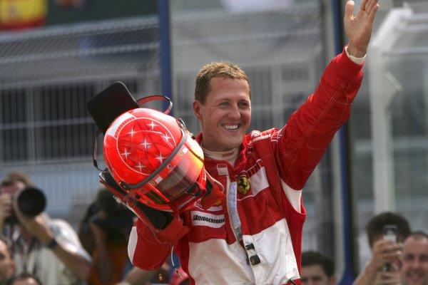 2006 German Grand Prix - Sunday Race Hockenheim, Germany. 27th - 30th July. Michael Schumacher (1st position), Ferrari, celebrates in parc ferme. Portrait, helmet. World Copyright: Steven Tee/LAT Photographic ref: Digital Image VY9E3795