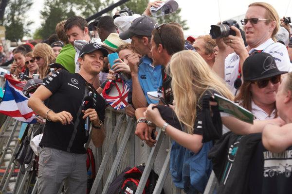 Silverstone Circuit, Northamptonshire, England. Saturday 4 July 2015. Nico Rosberg, Mercedes AMG, meets some fans. World Copyright: Steve Etherington/LAT Photographic ref: Digital Image SNE19021
